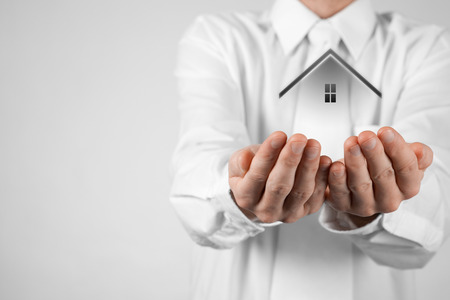 agents: Real estate agent offer house. Property insurance and security concept. White background. Stock Photo