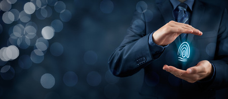 fingerprint: Privacy policy and security concepts. Protect your individuality in business. Businessman with protective gesture and fingerprint in hands. Wide banner composition with bokeh in background. Stock Photo