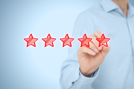 classification: Review, increase rating or ranking, evaluation and classification concept. Businessman draw five red stars to increase rating of his company.