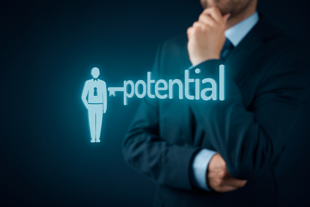 open minded: Unlock potential - motivational concept. Manager (HR specialist) think about motivation - symbol of the key connected with text potential and symbol of the businessman.