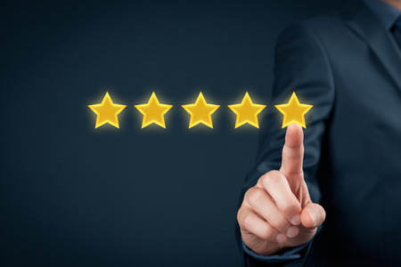 blue stars: Review, increase rating or ranking, evaluation and classification concept. Businessman click on five yellow stars to increase rating of his company. Stock Photo