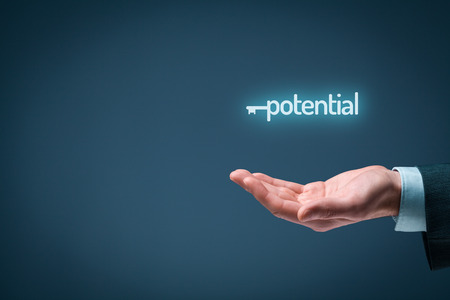 Unlock potential - motivational concept. Businessman with symbol of the key connected with text potential on hand. 版權商用圖片