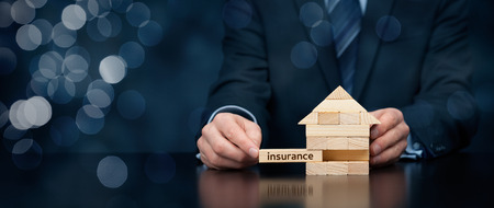 wooden houses: Property (family house) insurance protection concept.