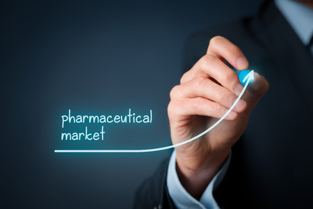 Growing pharmaceutical market concept. Businessman draw increasing graph illustrating growing pharma market. Stock Photo