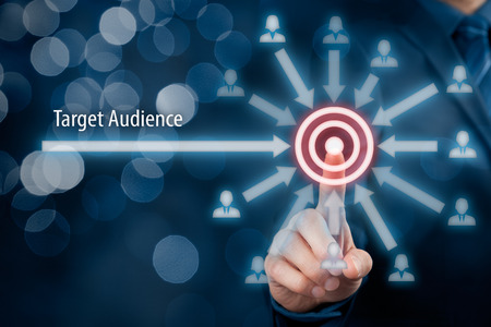Target audience concept. Businessman click on target, audience pointing to target is around target, bokeh in background. 版權商用圖片