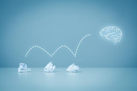 concept conceptual: Creative process concept - from failed idea to successful idea (problem solution). Icon of the brain representing idea. Stock Photo