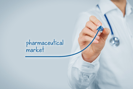 medical practitioner: Growing pharmaceutical market concept. Doctor (medical practitioner) draw increasing graph illustrating growing pharma market. Stock Photo