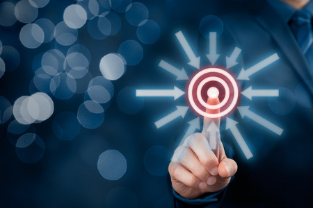 marketing target: Marketing targeting, goal and trigger concepts. Businessman click on virtual target, bokeh in background.