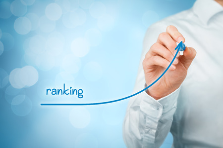 ranking: Increase ranking concept. Businessman draw plan to increase ranking of his company or website, bokeh in background.