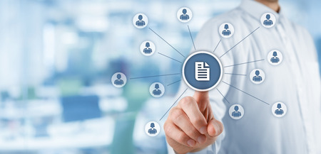 Corporate data management system (DMS) and document management system concept. Businessman publish document connected with corporate users working on notebooks with access rights, office in background.