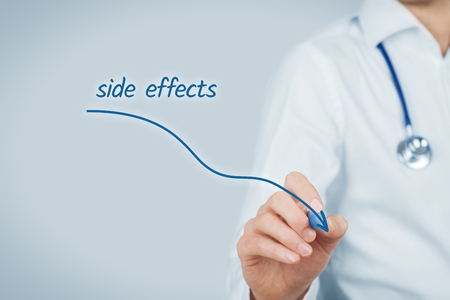 practitioner: Medical side effects concept. Doctor practitioner draw descending graph of the side effects of pharmaceuticals.