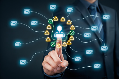 end user: Protect e-mail against spam (junk mail) concept. Envelopes representing e-mails, icons representing  information about mail and end user with notebook.