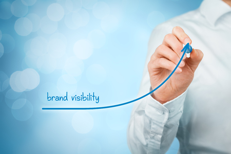 getting better: Brand visibility improvement concept. Brand manager (marketing specialist) draw growing graph with text brand visibility.