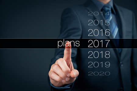 plan: Businessman planning year 2017. Business new year plans, goals and targets concept.