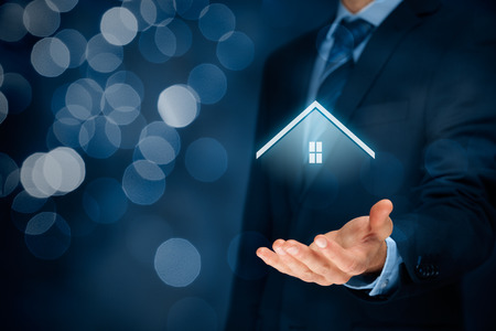 Property insurance and security concept. Protecting gesture of man and symbol of house. Stock Photo - 56358610