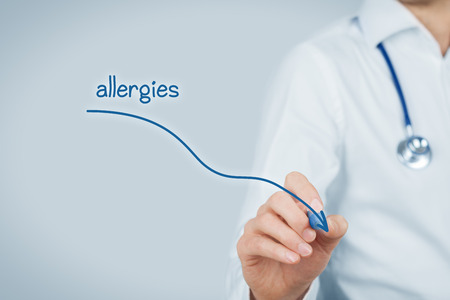 medical practitioner: Decrease allergies concept. Doctor (medical practitioner) draw decreasing graph of allergies. Stock Photo