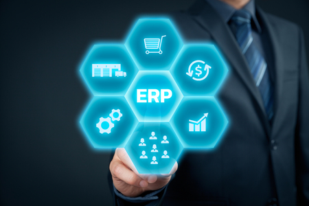 financials: Enterprise resource planning ERP concept. Businessman click on ERP business management software button for collect, store, manage and interpret business data like customers, HR, production, logistics, financials and marketing.