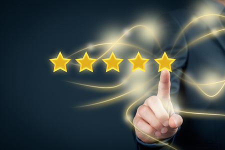 Review, increase rating or ranking, evaluation and classification concept. Businessman click on the fifth yellow star to increase rating of his company. Stock Photo - 56780012