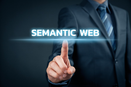 semantic: Businessman click on text semantic web (IT buzzword).