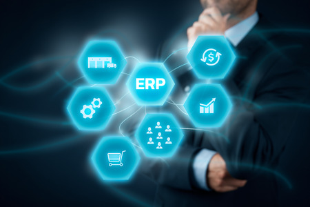 financials: Enterprise resource planning ERP concept. Businessman think about ERP business management software for collect, store, manage and interpret business data like customers, HR, production, logistics, financials and marketing.