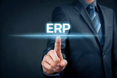 interpret: Enterprise resource planning ERP concept. Businessman click on ERP business management software for collect, store, manage and interpret business data.