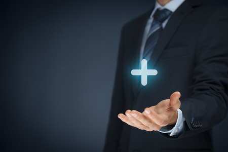 add: Businessman offer positive thing (like benefits, personal development, social networking) represented by plus sign. Stock Photo