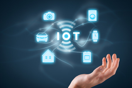 virtual technology: Internet of things (IoT) concept. Businessman offer IoT solution represented by symbol connected with icons of typical IoT � intelligent house, car, camera, watch, washing machine and cooker. Stock Photo