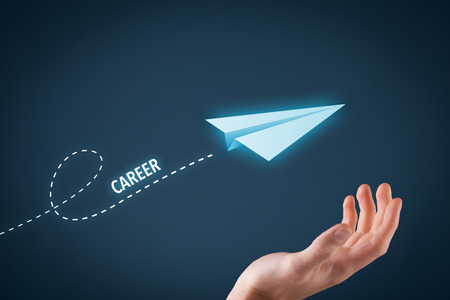 career development: Career acceleration concept, personal development, personal growth. Paper plane representing dreaming about career and hand touching this dream comes true. Stock Photo