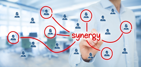 synergy: Synergy opportunity concept. Manager (businessman) connect team members with text synergy, cooperating team connected to this text.