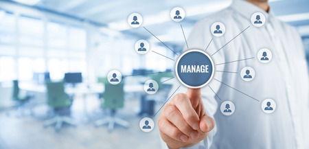 assign: Manager click on button with text manage. Managerial business concept. Wide banner composition with office in background. Stock Photo