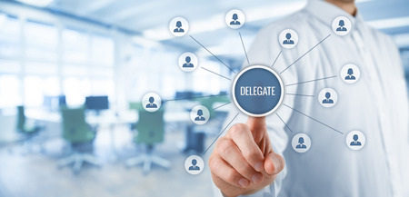 accredit: Manager delegate work on another person in team. Managerial concept with delegation. Wide banner composition with office in background.