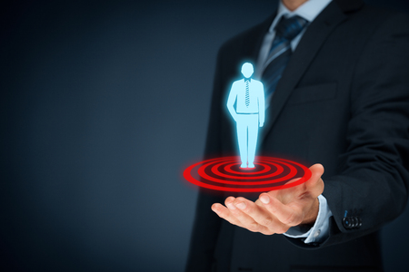 marketing target: Target customer (marketing) concept. Businessman hold target customer represented by virtual icon of man standing on target.