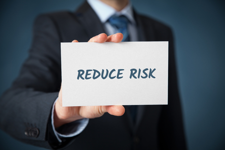 reduce: Businessman, investor, coach plan to reduce risk. Risk management concept.