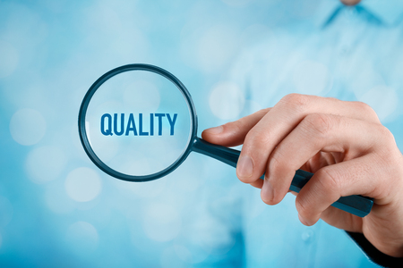 magnifying glass: Focused on quality concept. Manager (businessman, coach, leadership) is focused on quality in business.