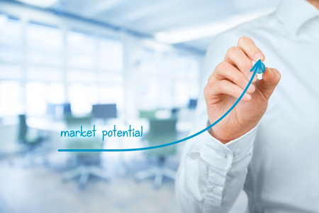 potentiality: Increase market potential for your business. Businessman draw growing line symbolize growing market potential, office in background.
