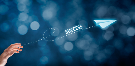 accelerate: Accelerate success concept. Businessman throw a paper plane symbolizing growing (accelerating) success. Wide banner composition with bokeh in background. Stock Photo