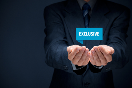 exclusivity: Exclusive offer and exclusivity business model. Businessman hold virtual label with text exclusive.