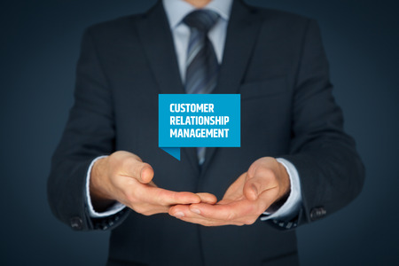 managerial: Customer relationship management (CRM) concept. Businessman hold virtual label with text Customer relationship management.