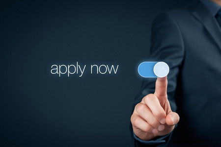 Apply now - human resources concept. Businessman switch-on button apply now. Imagens - 59047732