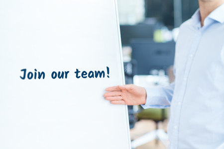 our company: Join our team concept. Businessman (recruiter, HR staffer) attract new employees on company presentation.