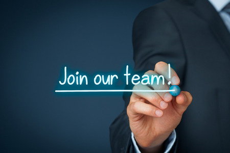 our team: Join our team concept. Businessman (recruiter, HR staffer) write and underline text join our team.
