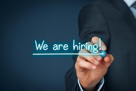 recruit help: Headhunter (recruiter) write and underline text we are hiring - human resources (HR) concept.