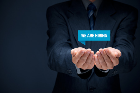 headhunter: Headhunter (recruiter) hold virtual label with text we are hiring - human resources (HR) concept.