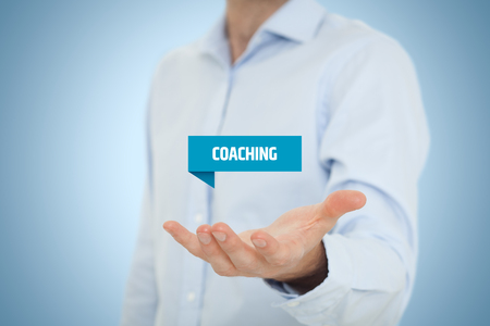 skill: Coaching advertisement concept. Coach show virtual label with text coaching. Stock Photo