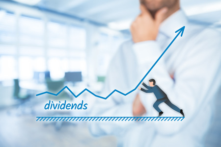 dividends: Increase dividends concept. Shareholder plan (predict) dividends growth represented by graph.  Stock Photo