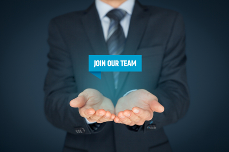 our team: Join our team concept. Headhunter (recruiter) hold virtual label with text join our team - human resources concept.