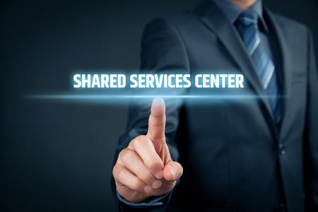 Shared services center (SSC) concept. Businessman click on text Shared Services Center.