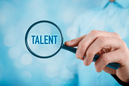 talented: Talent needed - human resources concept. Recruiter looking for (search) talented employees.