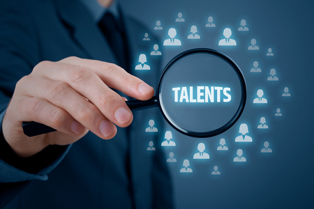 talent: Human resources or headhunter search talented managers and another business person. Stock Photo