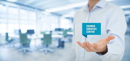 shared: Shared services center (SSC) concept. Businessman click on text Shared Services Center.